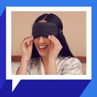 woman wearing slip sleep mask over eyes