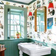 light green powder room with wallpaper