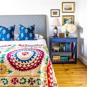 small bohemian bedroom with white walls