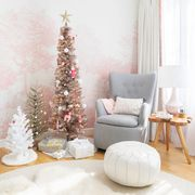 christmas trees clustered together in pink nursery