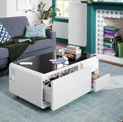 white coffee table with fridge drawer open, and snack drawer open in living room