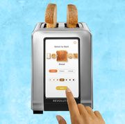 smart toaster with toast in it, light blue background