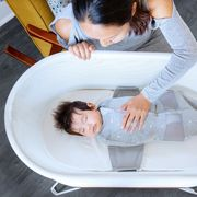 baby sleeping in snoo bassinet