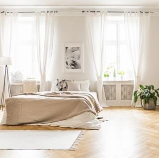 spacious and bright bedroom with sheer curtains