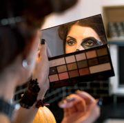 woman applying skeleton makeup for halloween