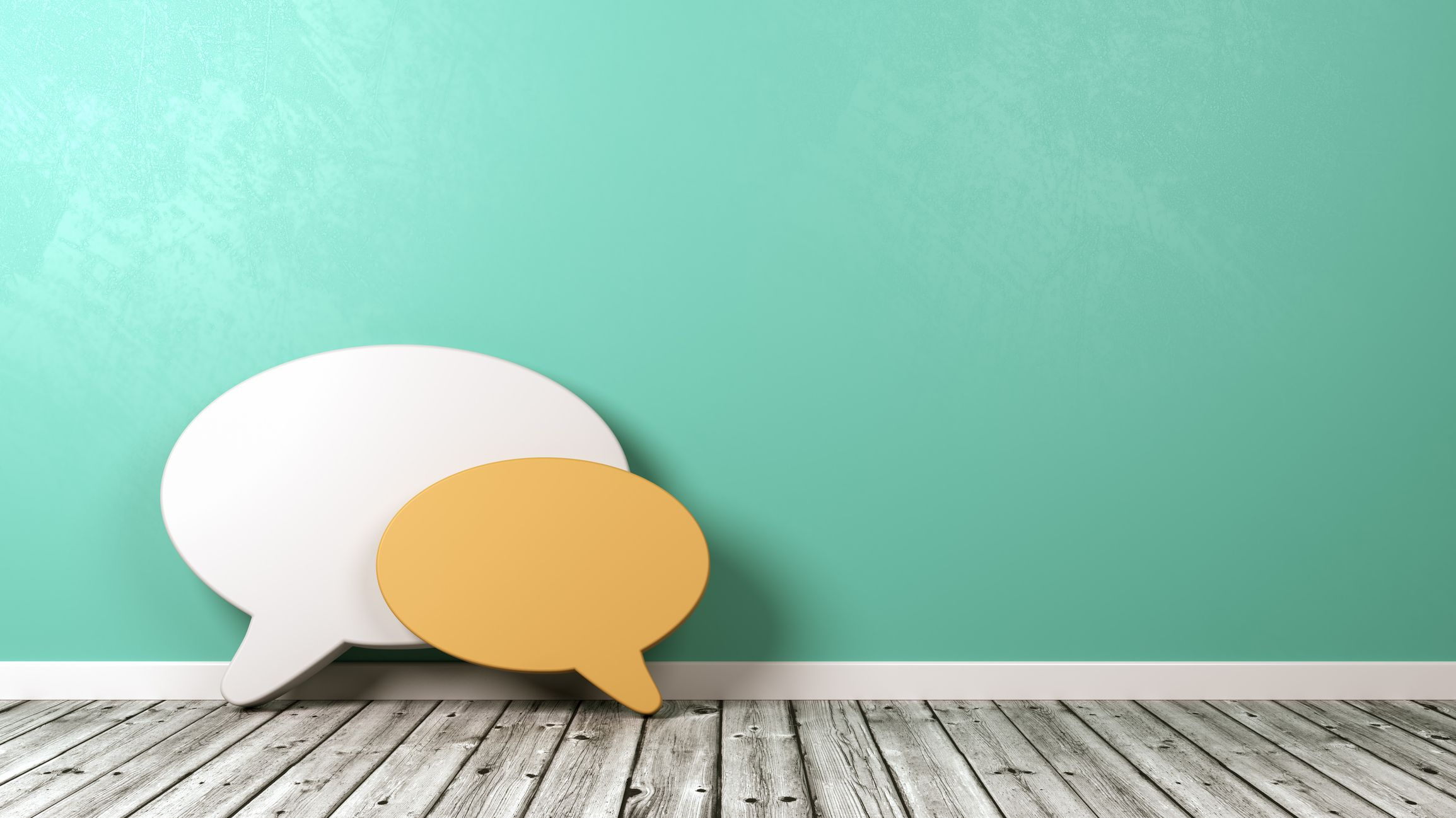 Speech Bubble Shapes Against Wall with Copyspace