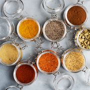 open glass jars with spices
