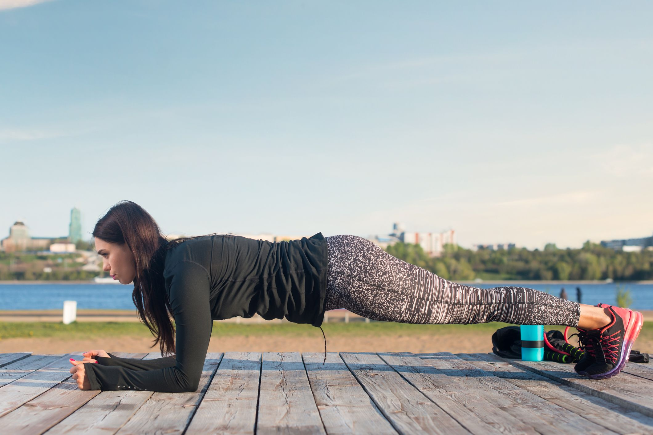 Sporty young woman doing elbow plank exercise working on abdominal