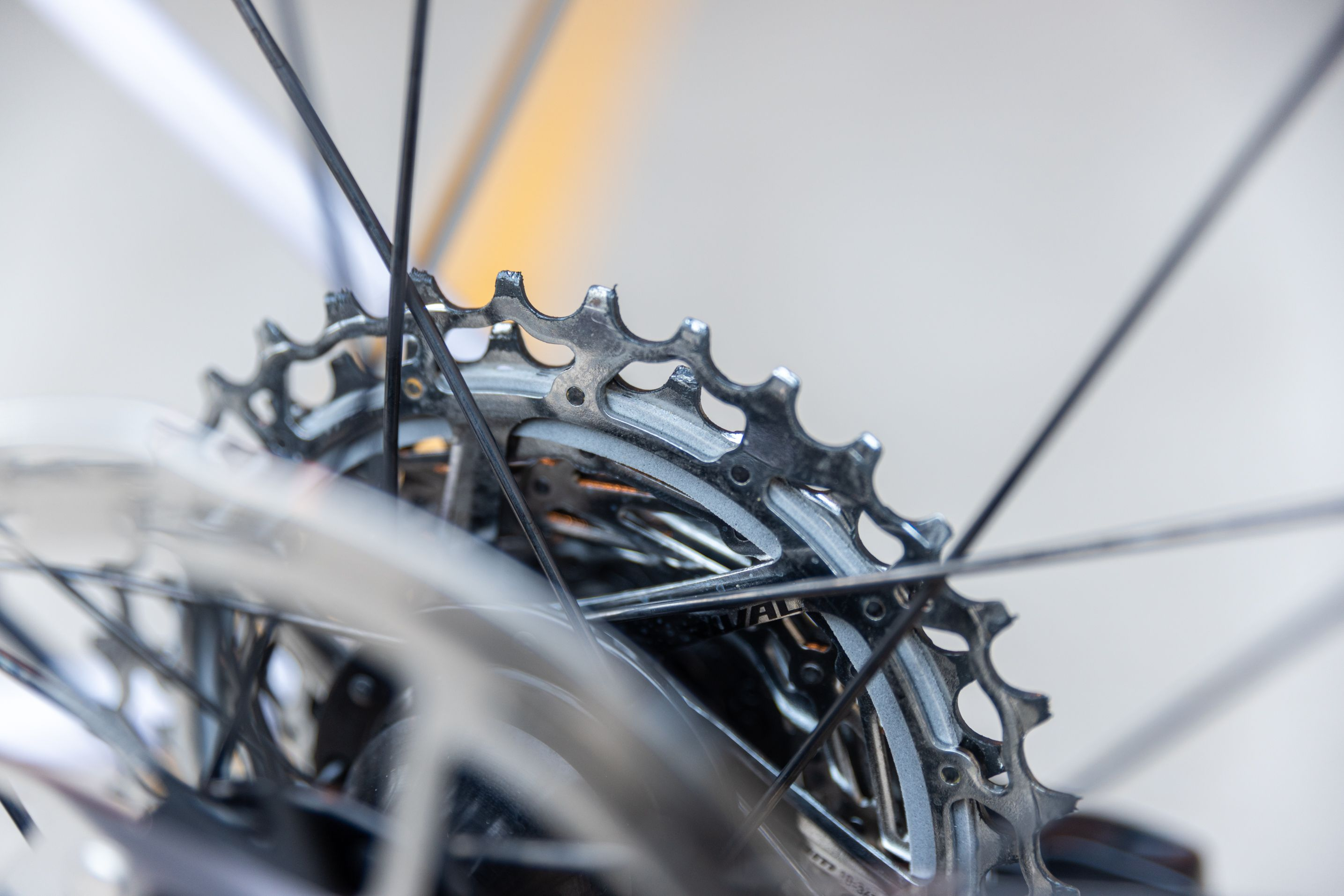 The Rival 12-speed cassette has a single sound damper ring (in gray) between the largest and second-largest cog.