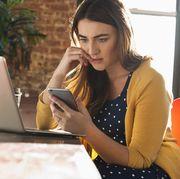 Stressed Caucasian businesswoman using cell phone