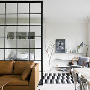 minimalist studio apartment with glass partition