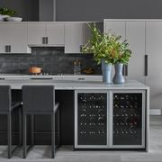 Countertop, Furniture, Kitchen, Room, Cabinetry, Interior design, Table, Material property, Tile, Gloss,