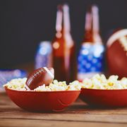 football bowls with popcorn and beers