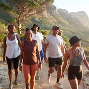group of people hiking in athletic gear