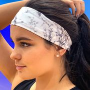 woman outside wearingsweat sports headband while exercising