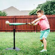 boy hitting baseball off tee