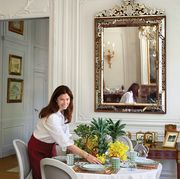Woman setting table with Dior