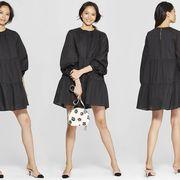 Clothing, Fashion model, Standing, Formal wear, Outerwear, Fashion, Little black dress, Dress, Sleeve, Footwear,