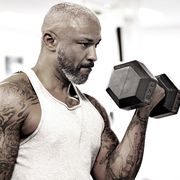 tattooed middle aged bearded black man at a gym