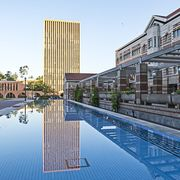 Reflecting pool, Building, Architecture, Daytime, Metropolitan area, Mixed-use, Condominium, Reflection, Human settlement, City,