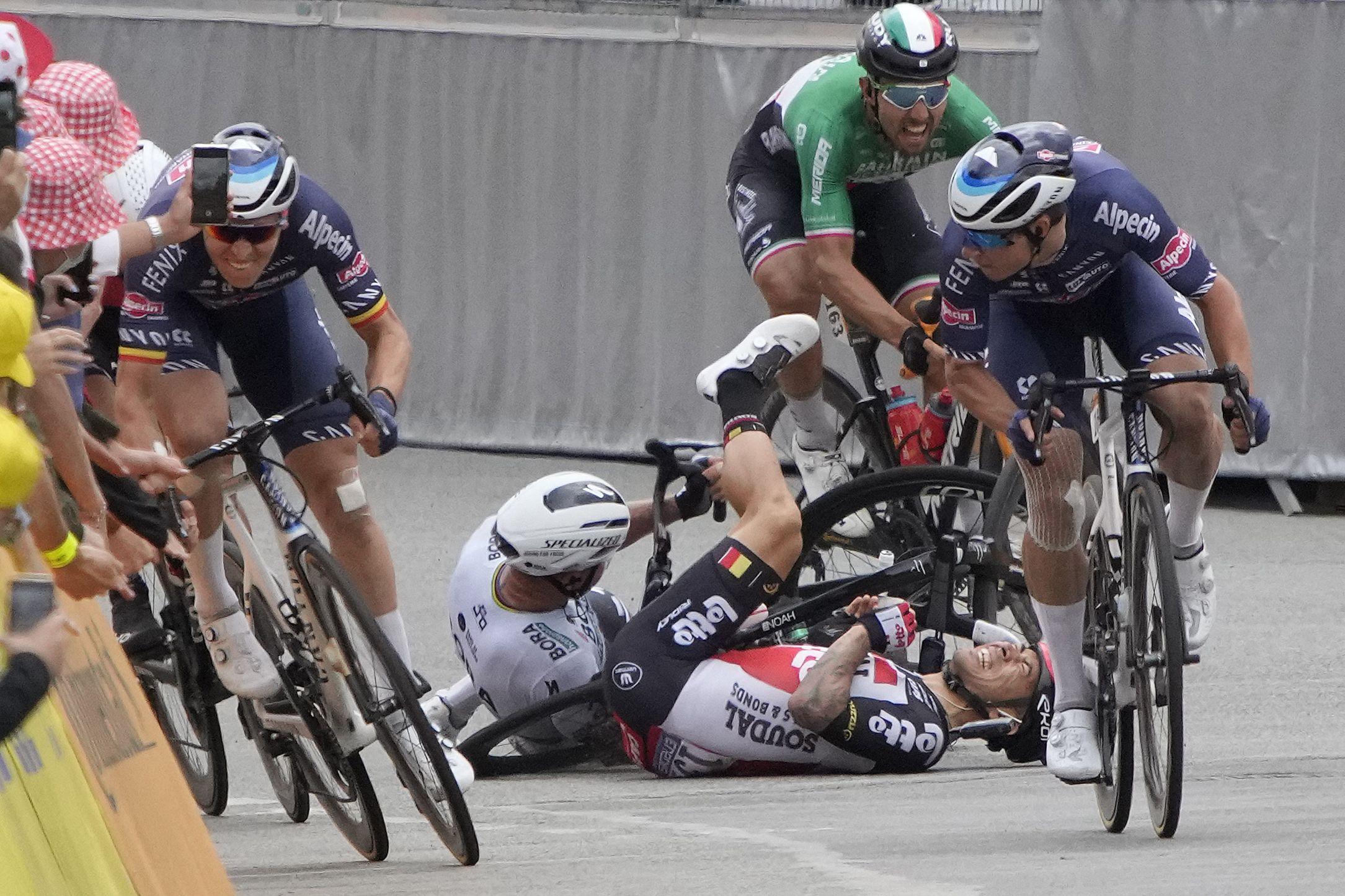 Caleb Ewan and Peter Sagan go down hard.