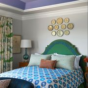 Room, Interior design, Green, Bed, Lighting, Bedding, Wall, Textile, Furniture, Ceiling,