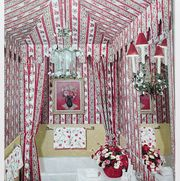 bathroom with wallpaper stripes and floral