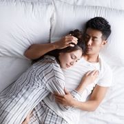 the young couple sleep in bed