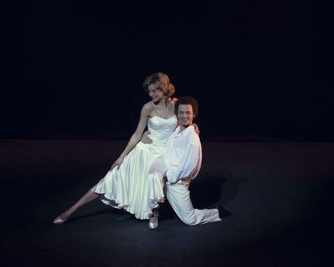 emma corrin as princess diana and jay webb as wayne sleep in the crown season 4