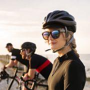 Three cyclists looking at view