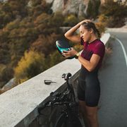 tired athlete woman after hard cycling training
