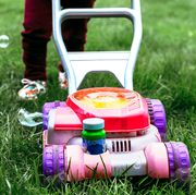 toy lawn mower blowing bubbles