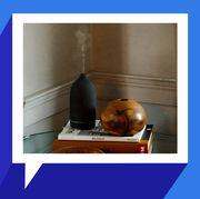 vitruvi diffuser on side table