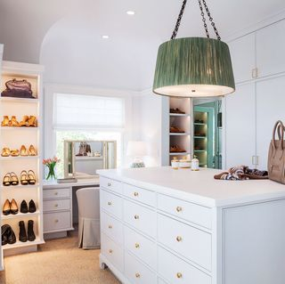 walk in closet with shoes on exposed shelves