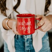 woman holding red warm and cozy mug