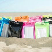 group of waterproof phone pouches in sand