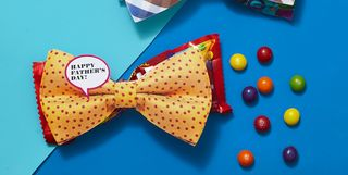 candy tucked under bow tie father's day gift
