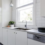 White and charcoal new renovated galley style Australian kitchen