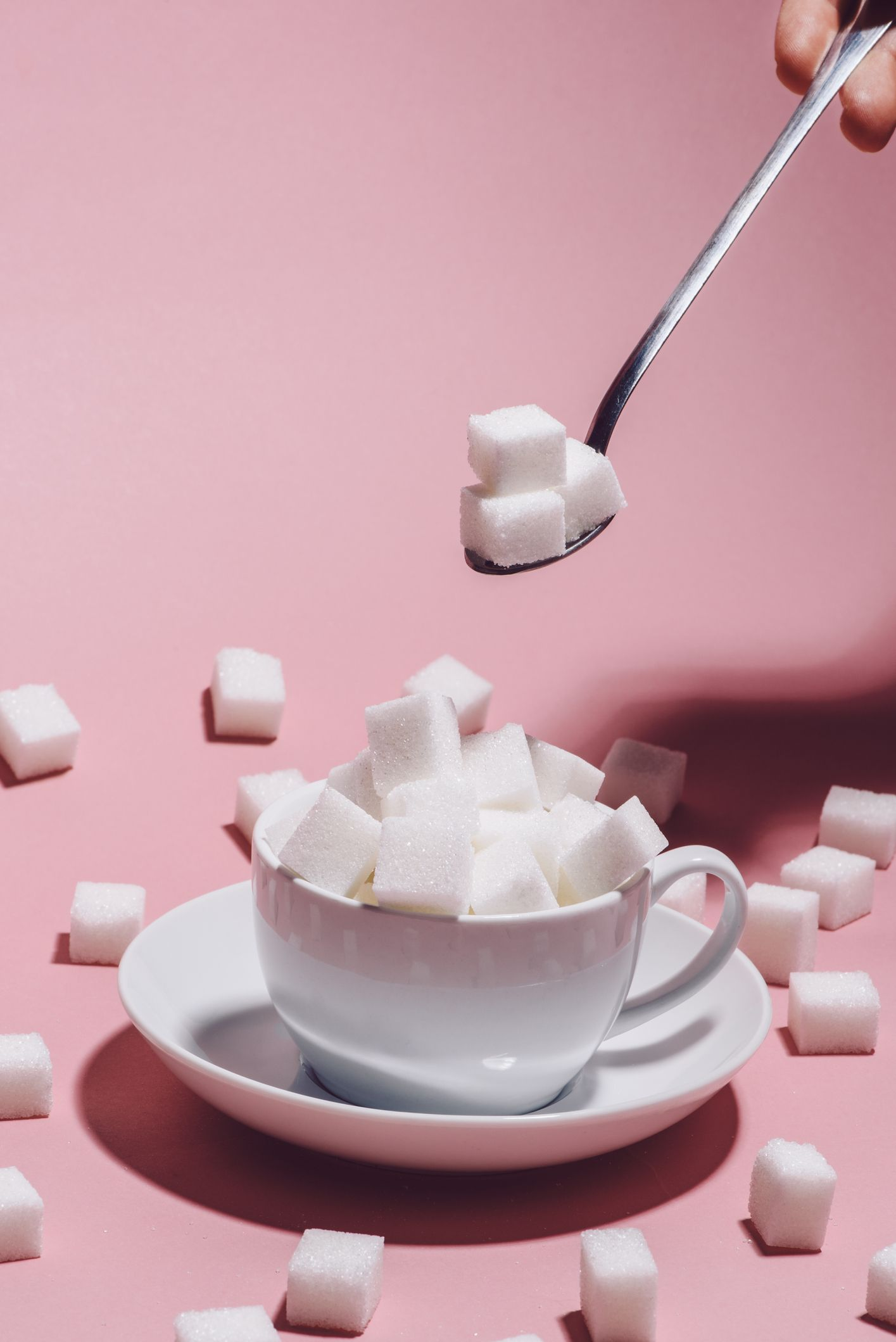 White cup full of sugar cubes