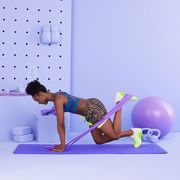 trainer kehinde anjorin performing quadruped resistance band leg exercise