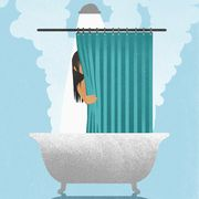 woman behind curtain in hot, steaming shower