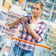 Woman buying food in supermarket