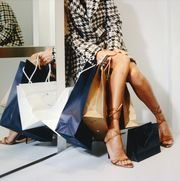 Woman Sitting with Shopping Bags