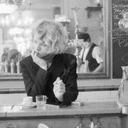 Woman Smoking at Restaurant Counter