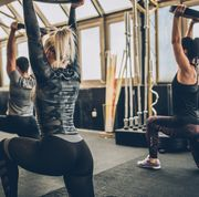 Women practicing together with fitness coach