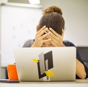 Businesswoman frustrated by bad new at office desk