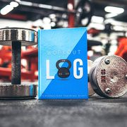 workout log journal with dumbbells in gym