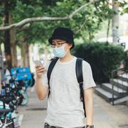 young asian man with protective face mask