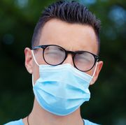 young man wearing a protective face mask and eyeglasses