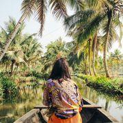 young woman kayaking through the backwaters of monroe island